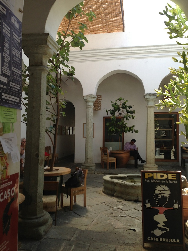 courtyard at Cafe Brujula, with fountain and tree tables