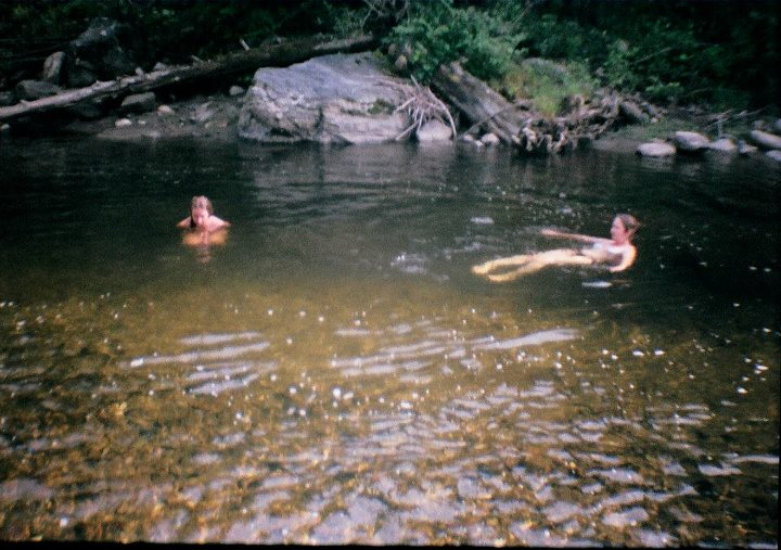 the author and her daughter swimming in a creek