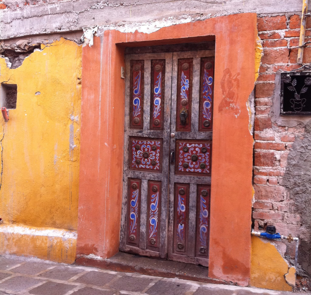 carved door in San Miguel de Allende